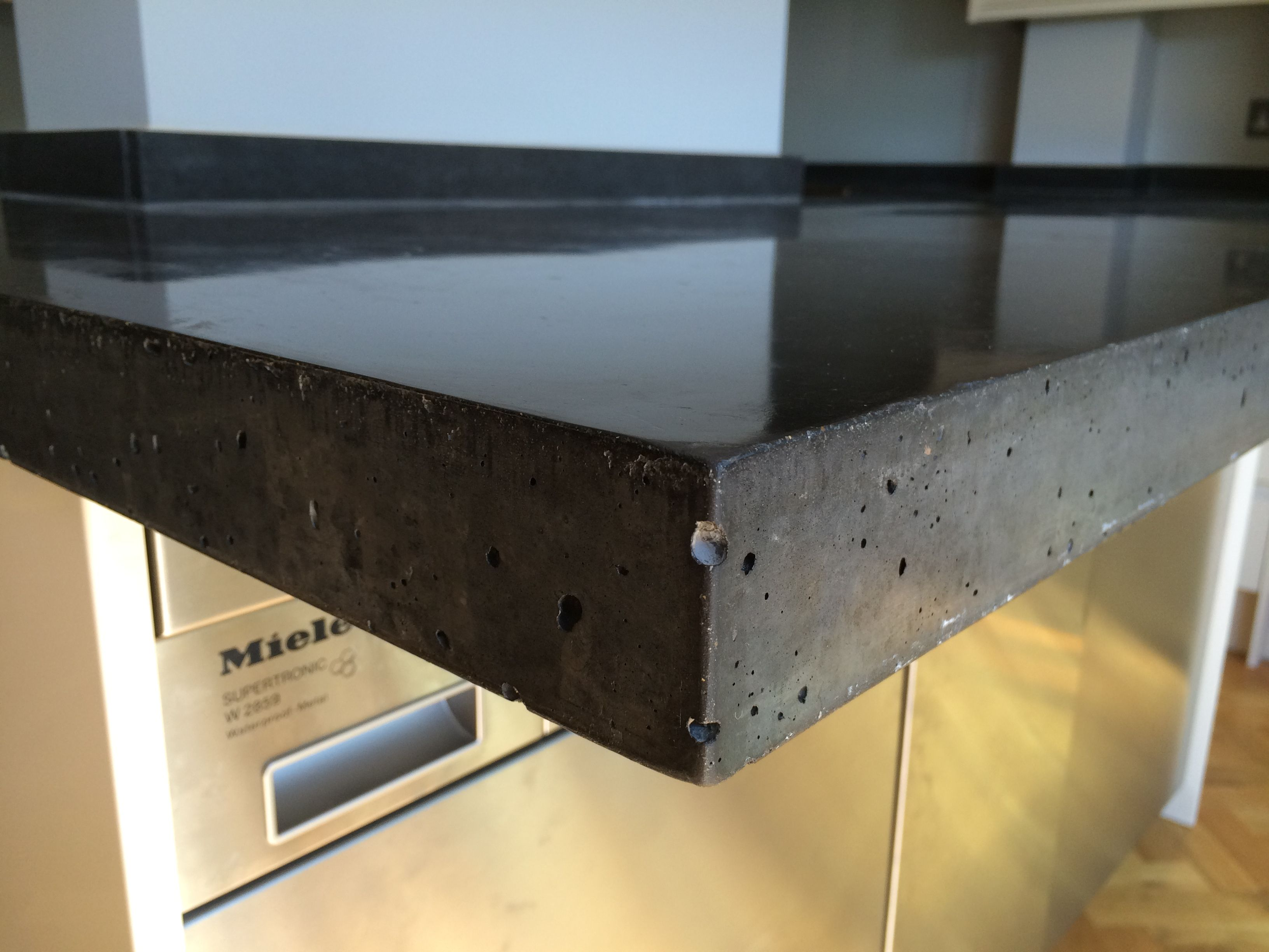 Detail Of 10 Black Oxide Polished Concrete Island Countertop Unit With Cantilever Breakfast Bar Polished Concrete Kitchen Concrete Kitchen Polished Concrete