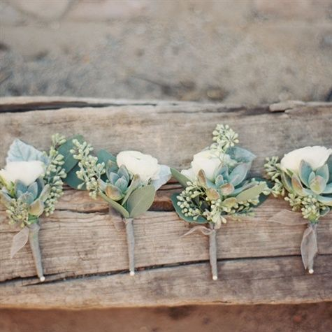 Delicate White Boutonnieres......The groomsmen accessorized with delicate white and green boutonnieres.