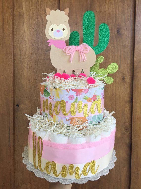 "Girl llama Baby Shower Decorations diaper cake, llama baby shower decorations, Girl cactus decor, cactus theme baby shower, llama party is part of Cactus decor Baby Shower - Our llama cactus inspired diaper cake will make a lovely centerpiece at your shower event  We add lots of different elements on our llama diaper cake! There are handcrafted decorations, pom poms, colorful yarn, and words on cake are made with durable glitter cardstock  We can modify colors for your shower if desired  Included in our 2 Layer Cake  50 Quality Diapers size 1, all decorations as shown  We can modify the colors on the diaper cake, all of the toppers are hand crafted by me made with durable cardstock paper  Words on cake read Mama Llama  Pom poms, yarn, and satin ribbons  Diaper Cake sits on a 12"" cake round"