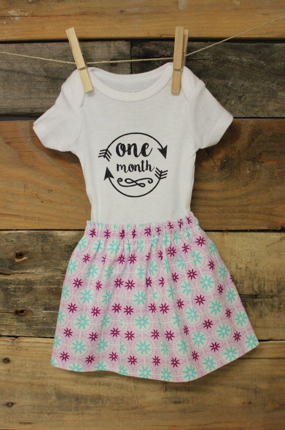 Celebrate your baby girl turning one month old with this sweet onesie  dress. Perfect outfit