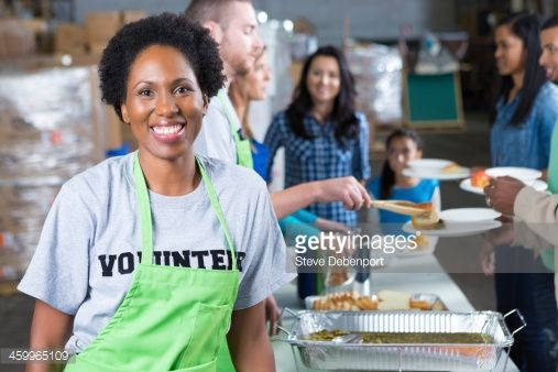 African American Woman Volunteering At Community Soup Kitchen
