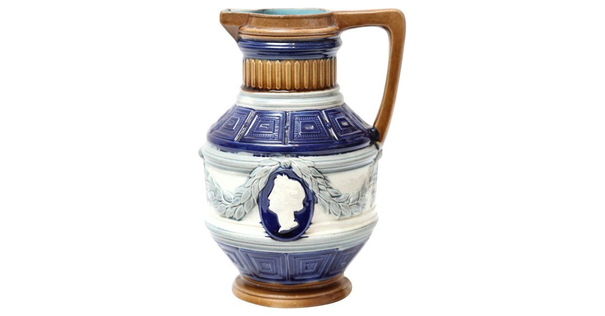 English majolica pitcher with man and woman cameos with draped laurel leaves. No maker's mark. Minor wear.