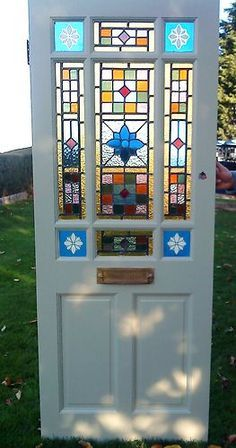 Blue stained glass front door google search home ideas pinterest glass front door for Stained glass exterior front doors