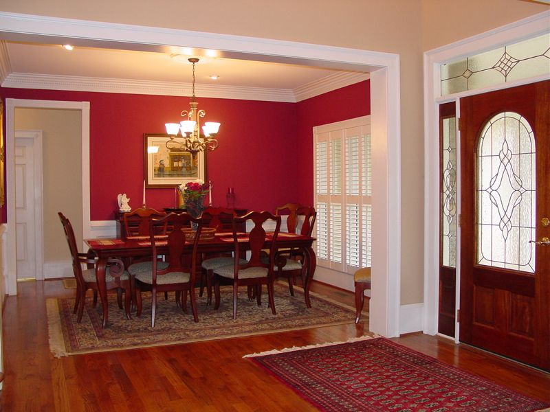 Open Foyer Formal Red Dining Room