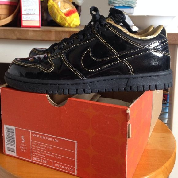 Women's Nike Dunk Low Worn once and in new condition.  Color:  Black/Black-Metallic Gold Nike Shoes