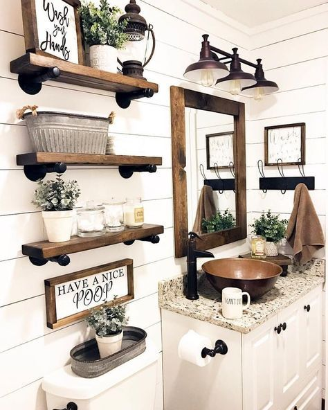 Photo of This vintage inspired farm bathroom is decorated with wood tones, …