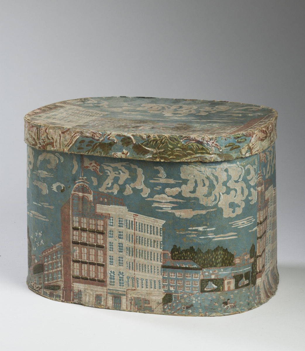 HOLT'S NEW HOTEL, NEW YORK CITY. A BLUE HATBOX WITH DOWNTOWN SKYLINE