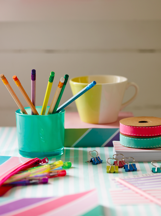 Studying essentials for university: colourful stationery and a good mug!