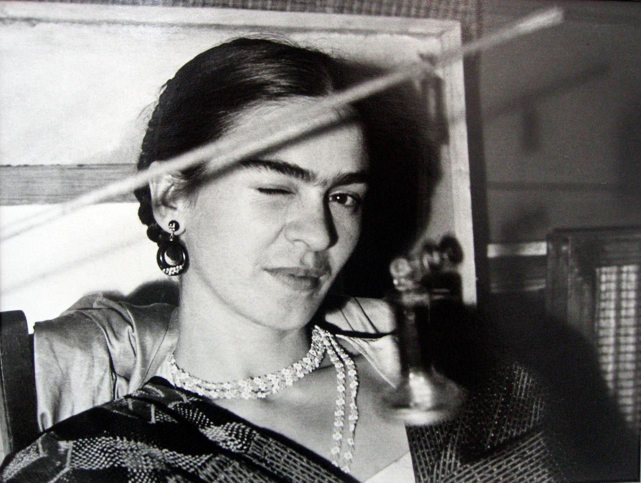 Frida Winking From A Unique Collection Of Portrait Photography