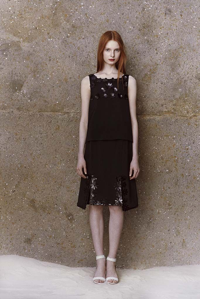 Black crepe open back cropped top and double slit skirt with leather flower trim from HONOR's Resort 2015 collection.