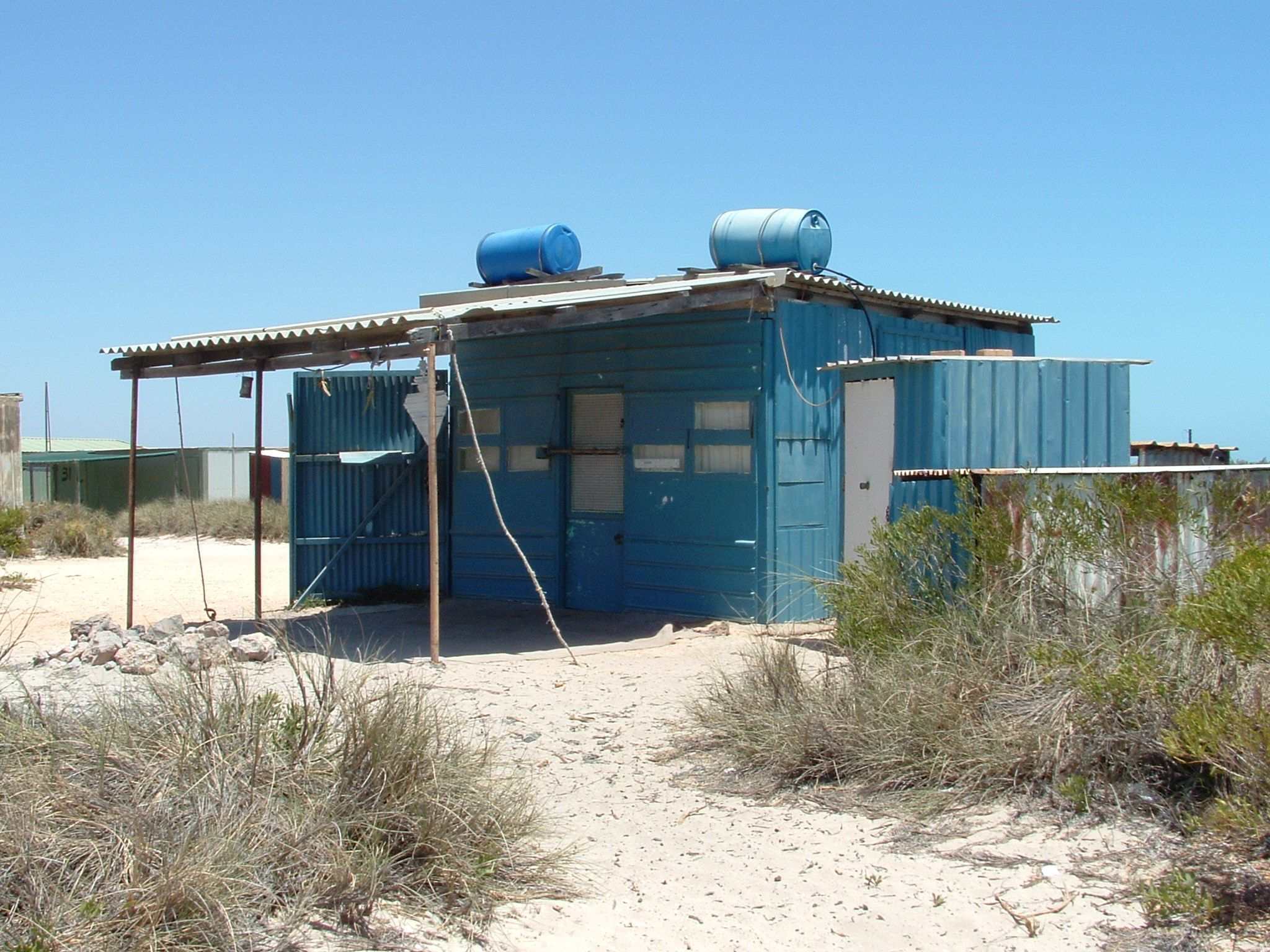 Beach shack : http://www.wanowandthen.com/blowholes.html