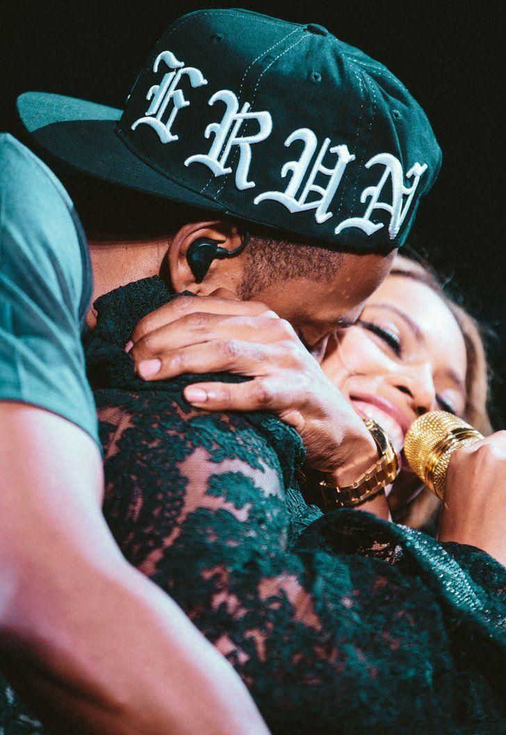 Jay Z hugging Beyoncé