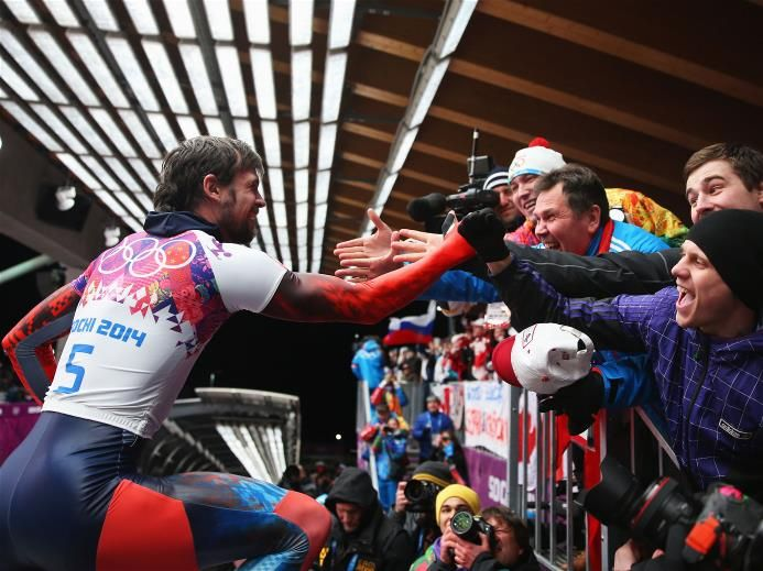 Alexander Tretiakov of Russia celebrates winning gold after his run during the Men's Skeleton on Day 9 of the Sochi 2014 Winter Olympics at Sliding Center Sanki