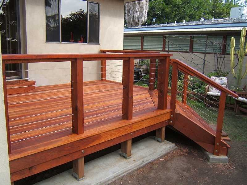 Dark Finishing Wooden Deck Idea With Thin Stainless Steel