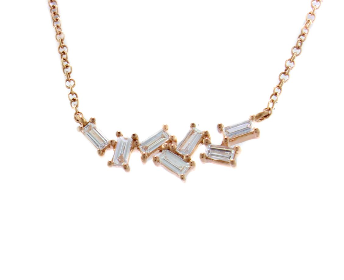 35d6a2e96e3afe Our baguette necklace is subtle yet strong with 0.30 carats of diamonds set  in fourteen karat rose gold and rests just below the collarbone.