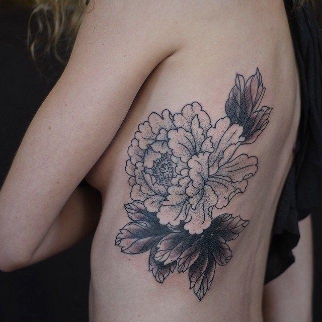 Flower Outlines Rib Tattoo                                                                                                                                                                                 More