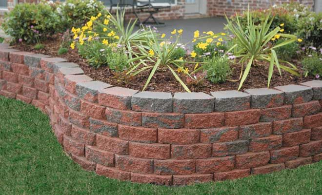 Red brick retaining wall for around trees in the front for Raised garden wall ideas