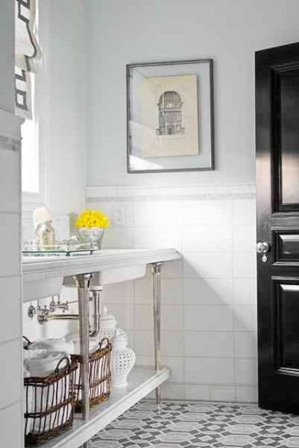 Bathroom with a black lacquer door, mosaic tile floor, and chrome
