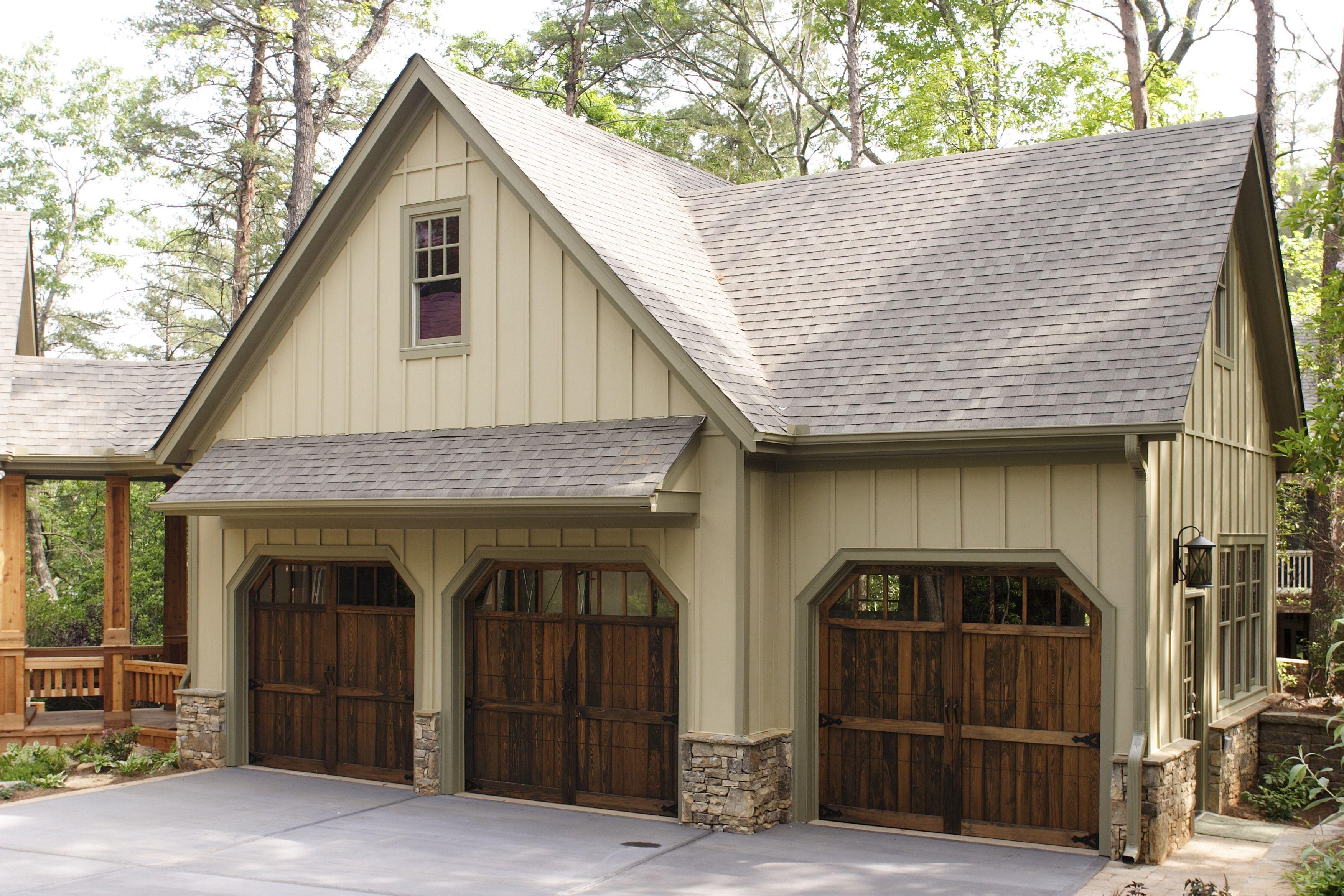 Wooden Garage Doors Give This Garage An Exquisite Homey Feel Remodels Include A Concrete Driveway Shingl Garage Door Design Garage Design Wooden Garage Doors