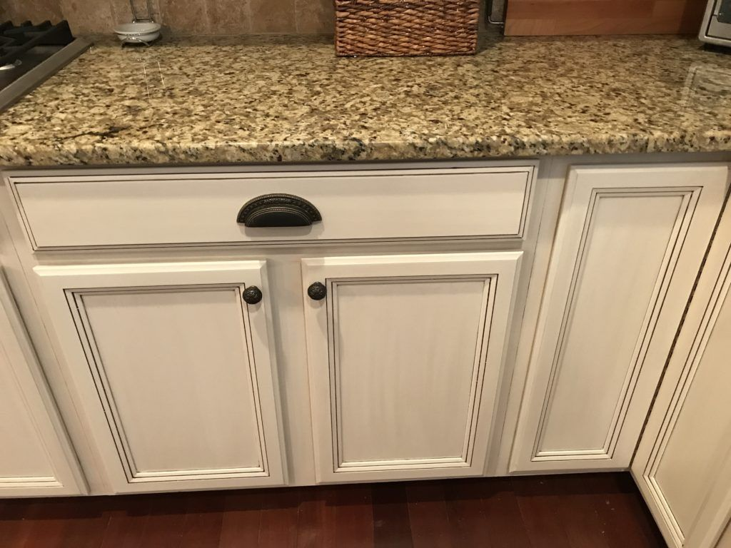 Adding Brown Sugar Glaze To These Cabinets Helped To Create More Of A Custom Tuscan Feel In 2020 White Glazed Cabinets Glazed Kitchen Cabinets White Kitchen Cupboards