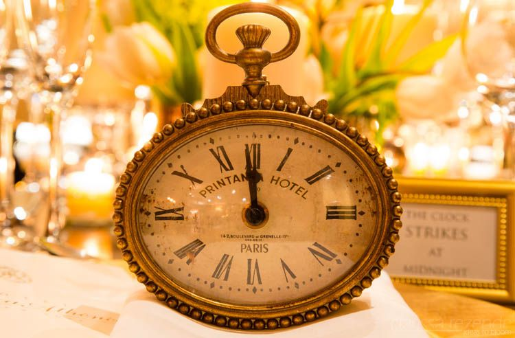 """Clock set to 1 minute to midnight in a #black and #gold #newyearseve party with the theme """"Countdown""""."""