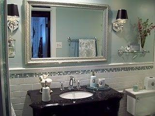 Subway tile, glass tile border, oversized mirror.