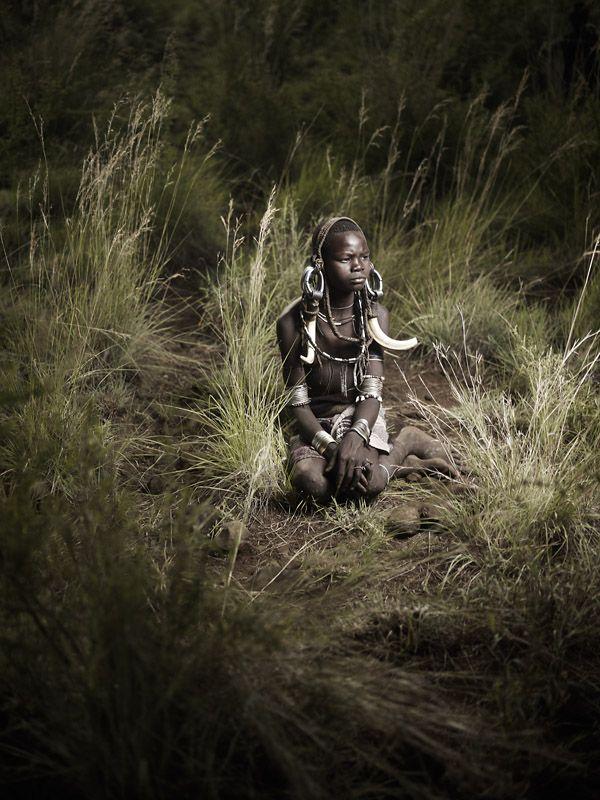 Mursi Boy in Tall Grass