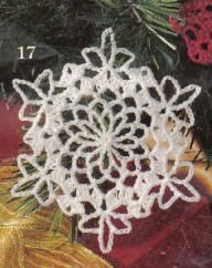 Free crochet pattern for a white snowflake Christmas Tree ornament. I add a little watered down white glue on one side then sprinkle clear diamond dust or mica flakes on.