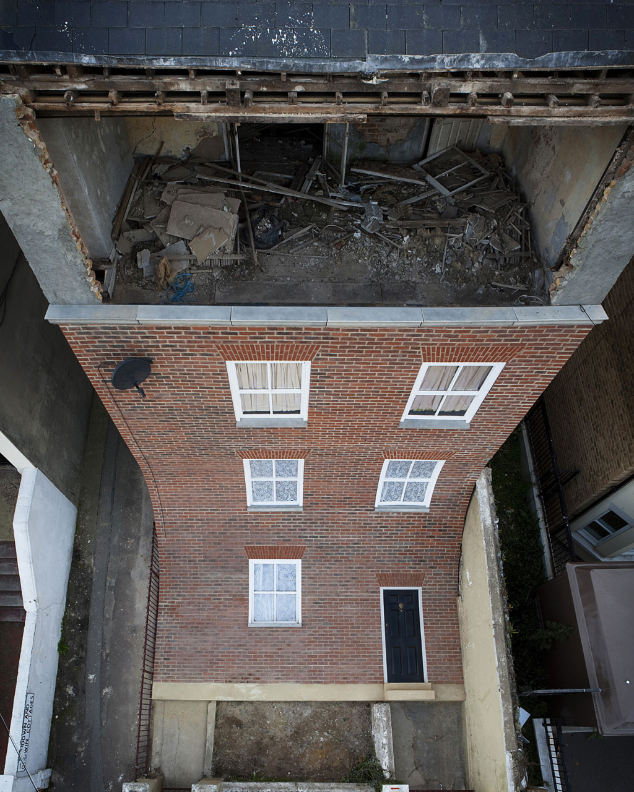 A Brand New Brick Facade Slides Off The Front Of A