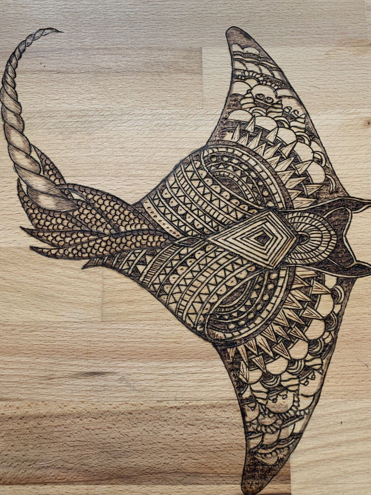 Large cutting board wood burned with a Manta Ray.
