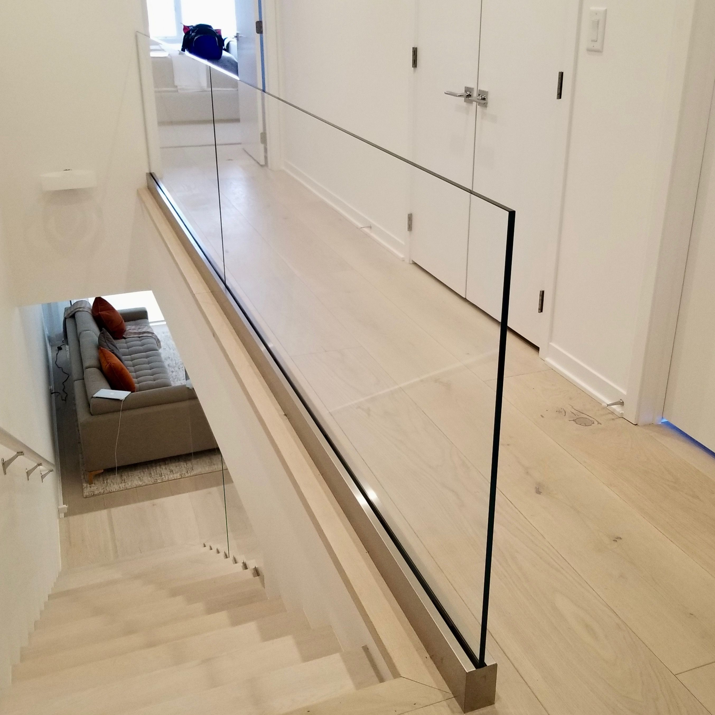 Update Your Hallway Glass Panel Railing Opens Up A Narrow Hallway | Glass Staircase Panels Near Me | Glass Railing Systems | Wood | Spiral Staircase | Stair Parts | Stainless Steel