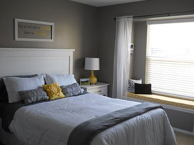 Yellow, grey and white bedroom.
