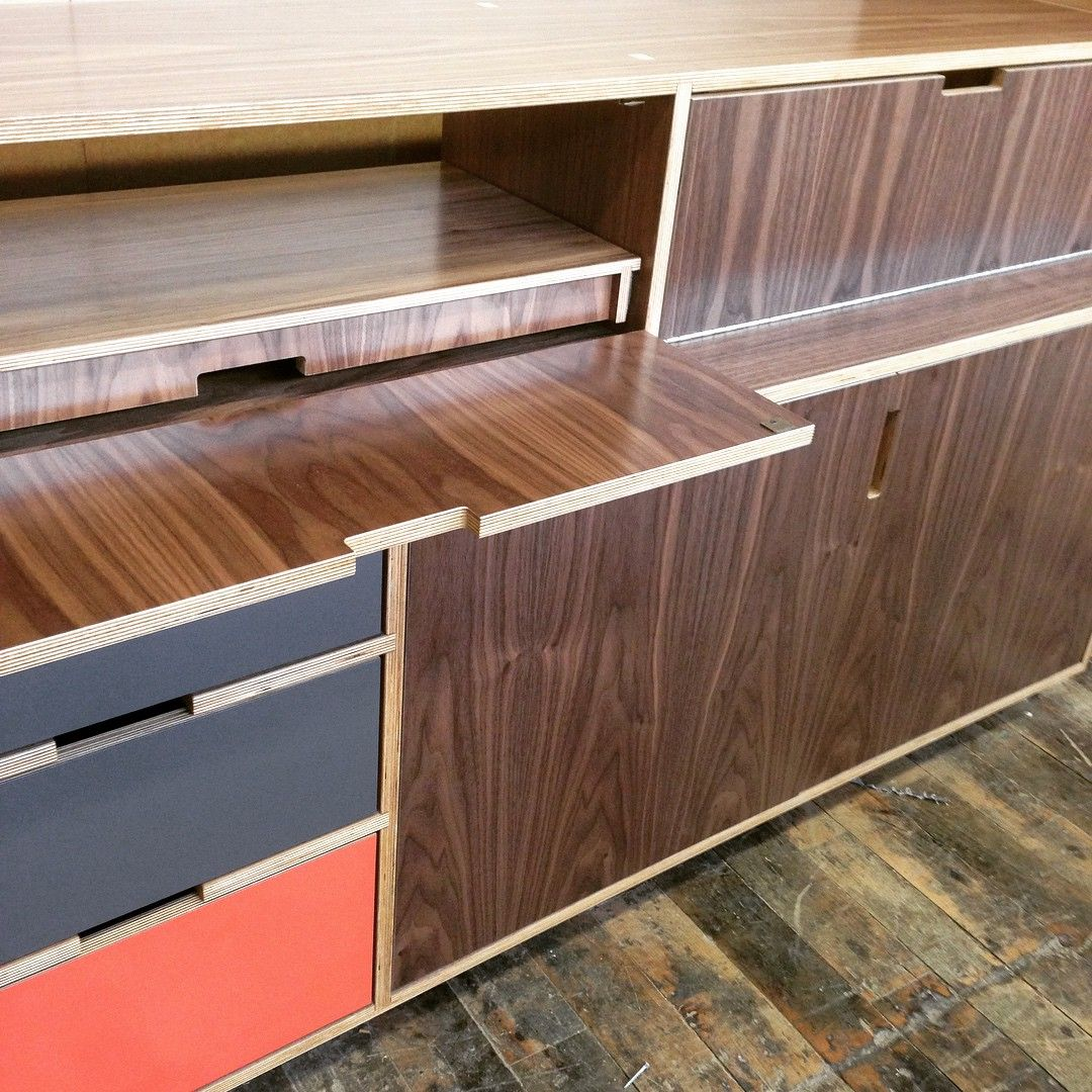 Flip down door with full internal drawer pull out to hide all those pesky electronics. Walnut europly bookcase made by Kerf Design in Seattle, Washington kerfdesign.com