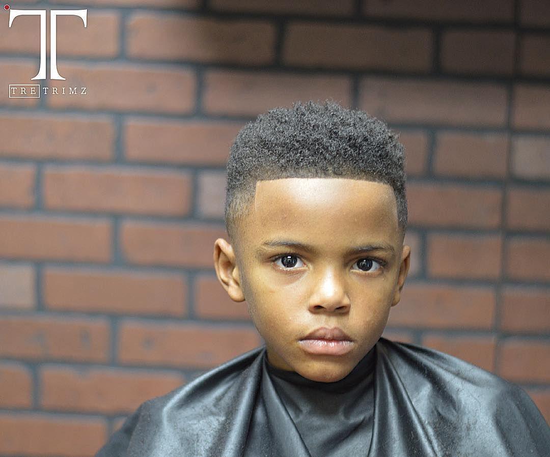 line haircut black boy