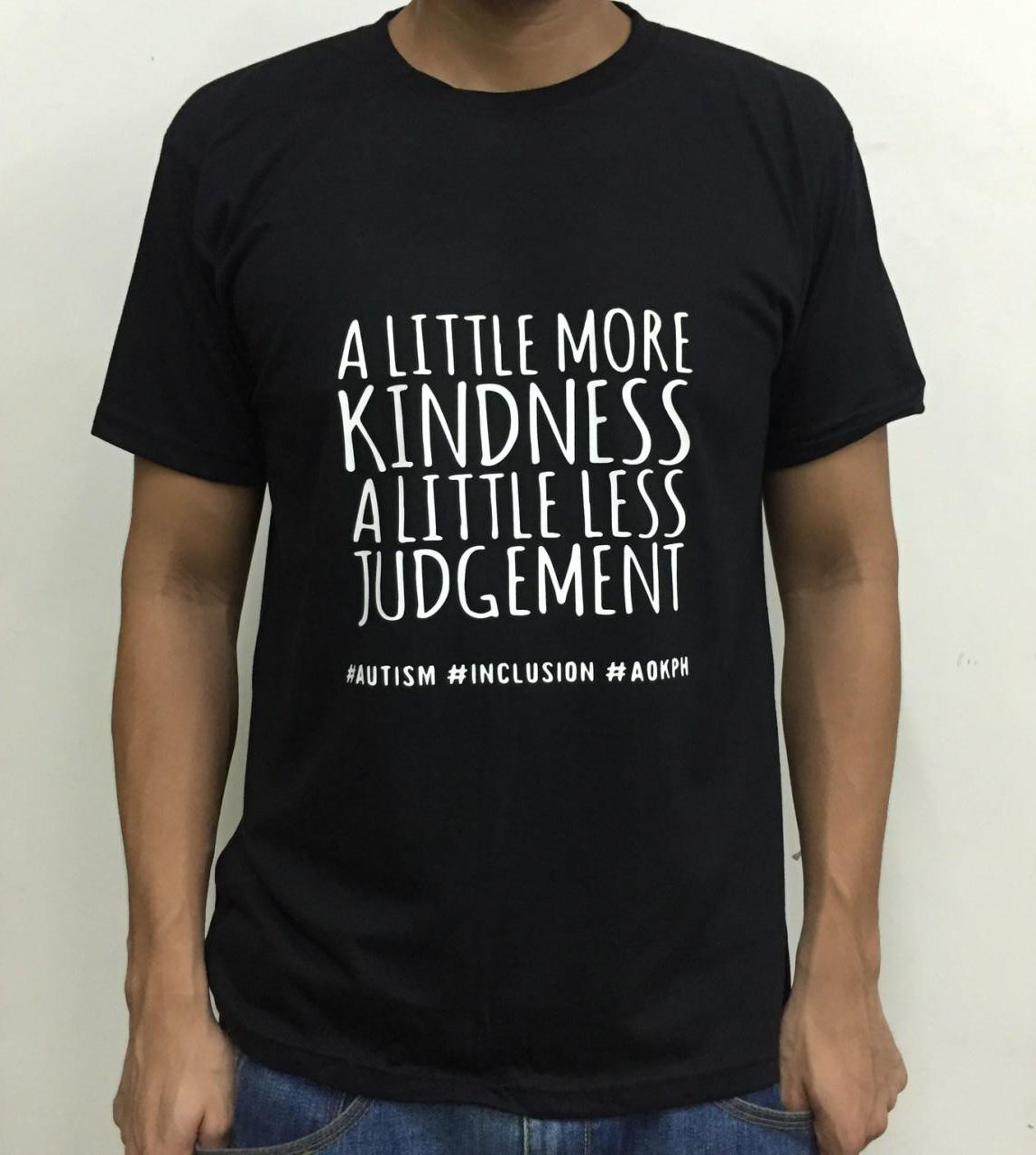"""This cotton shirts bear ASP's """"Hugot"""" lines which celebrate life on the autism spectrum.  """"A little more kindness. A little less judgement."""" Genuine acceptance of people with autism mean accommodation of their deficits which can put them on an equal playing field with the neurotypical.    Order this item at: https://autismall.myshopify.com/products/shirt-a-little-more-kindness"""