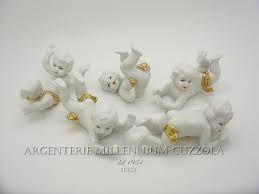 Risultati immagini per angeli usati porcellana