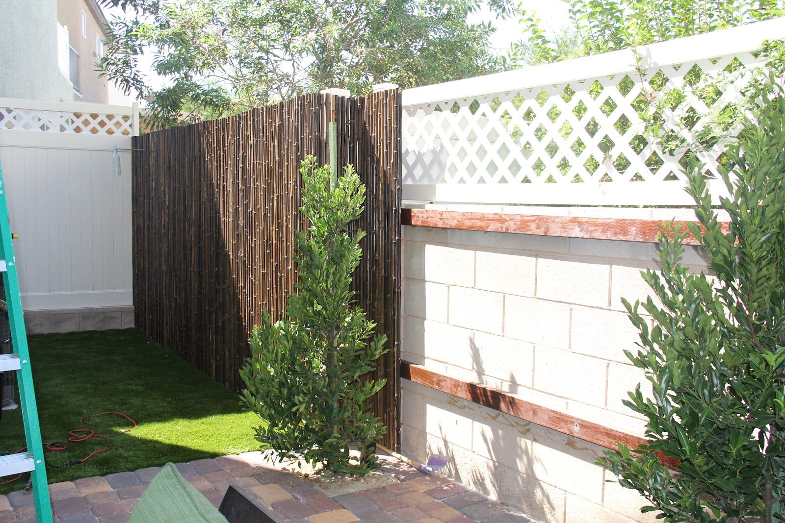 Bamboo fencing as inexpensive diy or paid option to cover - How to cover exterior cinder block walls ...