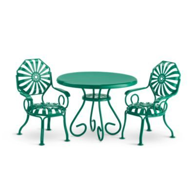 Kit's Table & Chairs With its fanciful silhouette, this jade-green metal table and chair set is the center of celebration for Kit's best birthday party ever. And when the party's over, it offers the perfect spot for Kit and a friend to sit and enjoy a cool glass of lemonade on a hot summer day. The set features:  Authentic 1930s-design table with graceful curves that will stand up to years of celebrations. Two chairs, featuring a sunburst cutout design that was popular during Kit's day.
