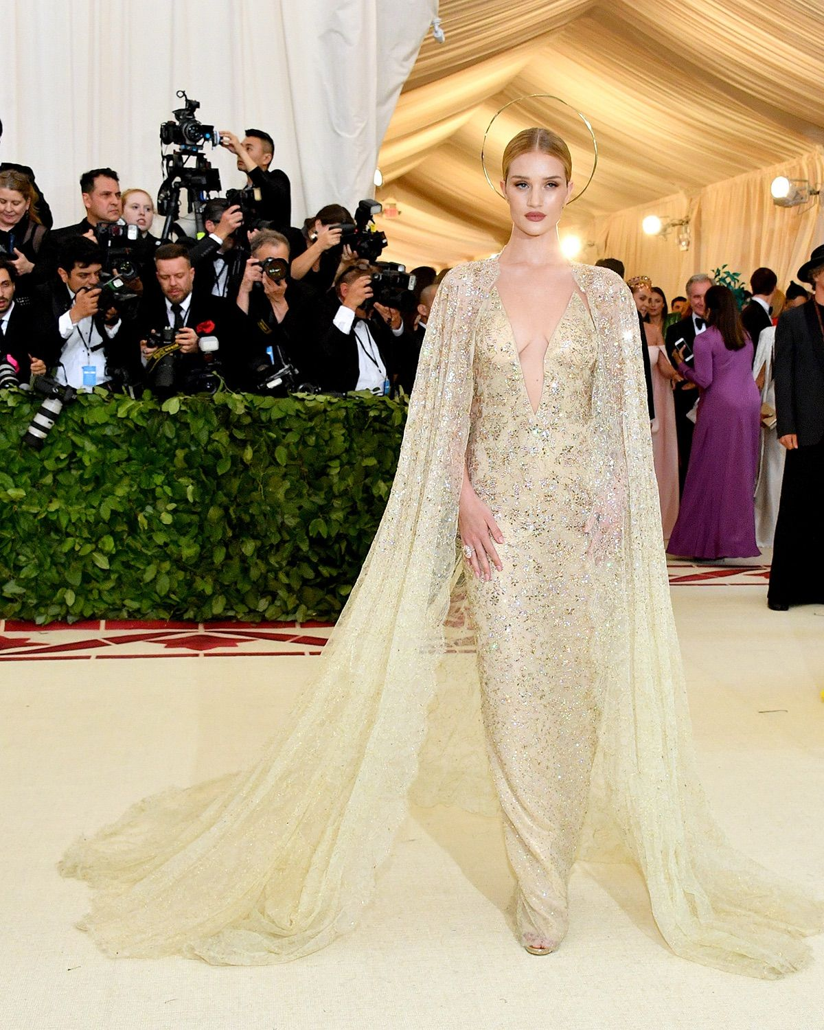 Rosie Huntington-Whiteley wears a caped Ralph Lauren Collection