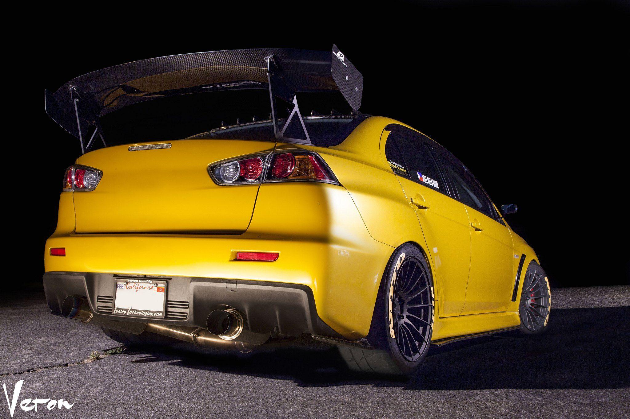 Aftermarket Parts Transform Yellow Mitsubishi Evolution