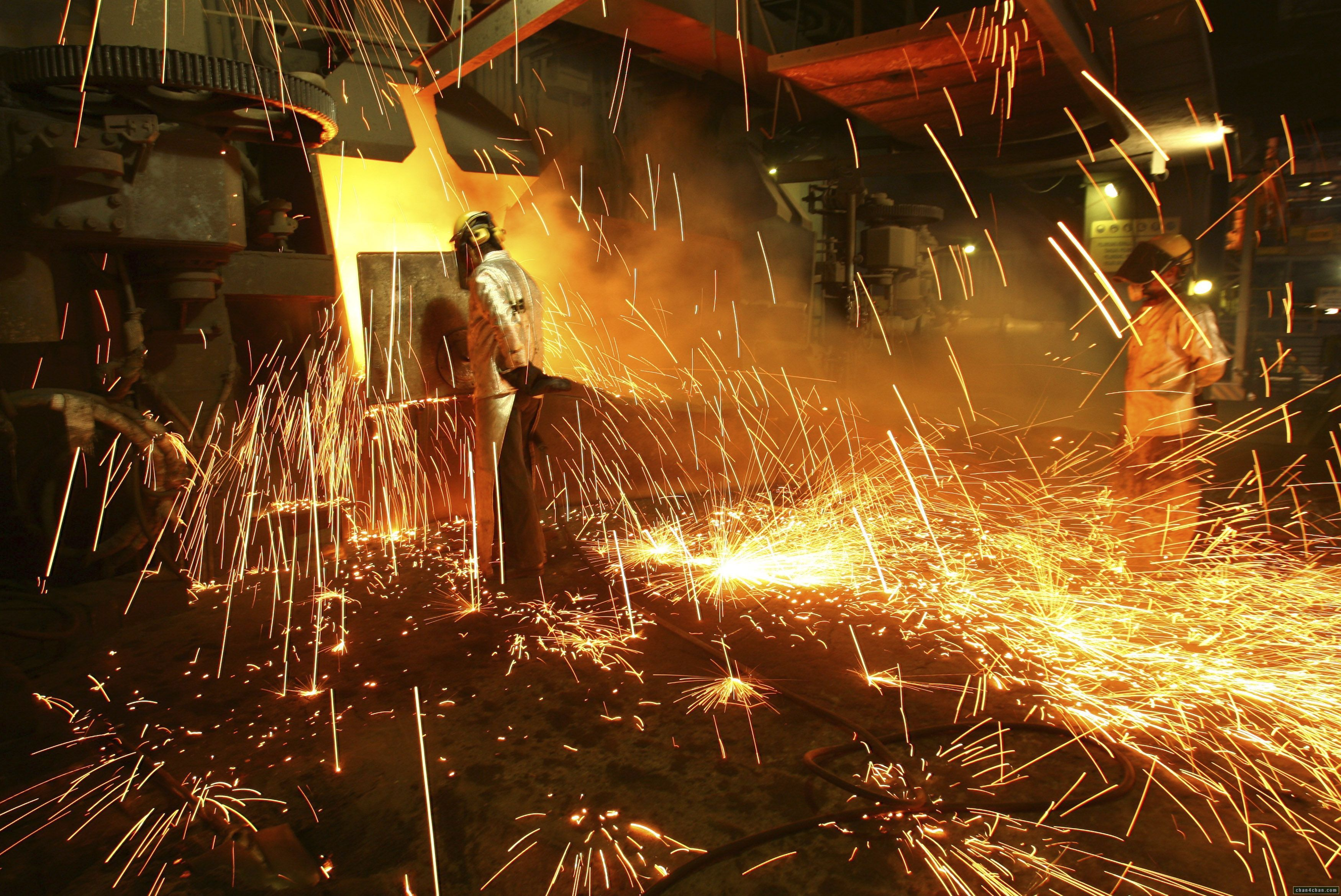 Furnace at a foundry throws out sparks. Business and