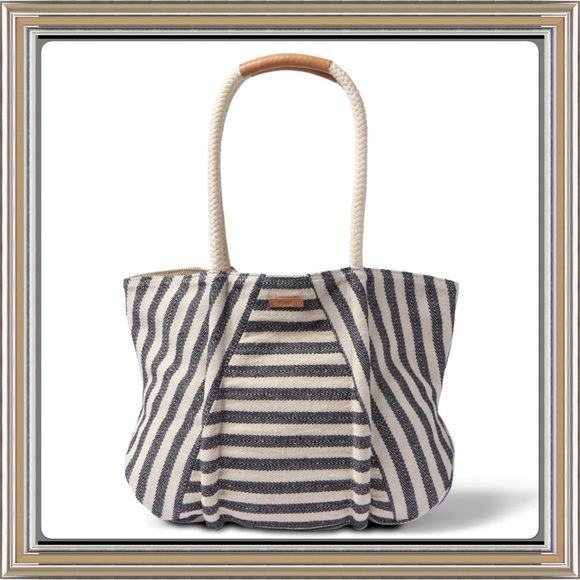 """BNWT Navy Rivera Stripe Mix Tote from TOMS ✨BNWT✨ Such a cute summer tote!!!  Currently SOLD OUT in stores.  Carry the day in classic nautical style with this crisp, striped cotton and rope tote from TOMS. Double handles. Magnetic closure; lined. Two interior slip pockets, interior zip pocket. 16""""L x 4""""W x 14""""H; 11"""" handle drop.  Color: Navy Riveria Stripe. TOMS Bags Totes"""