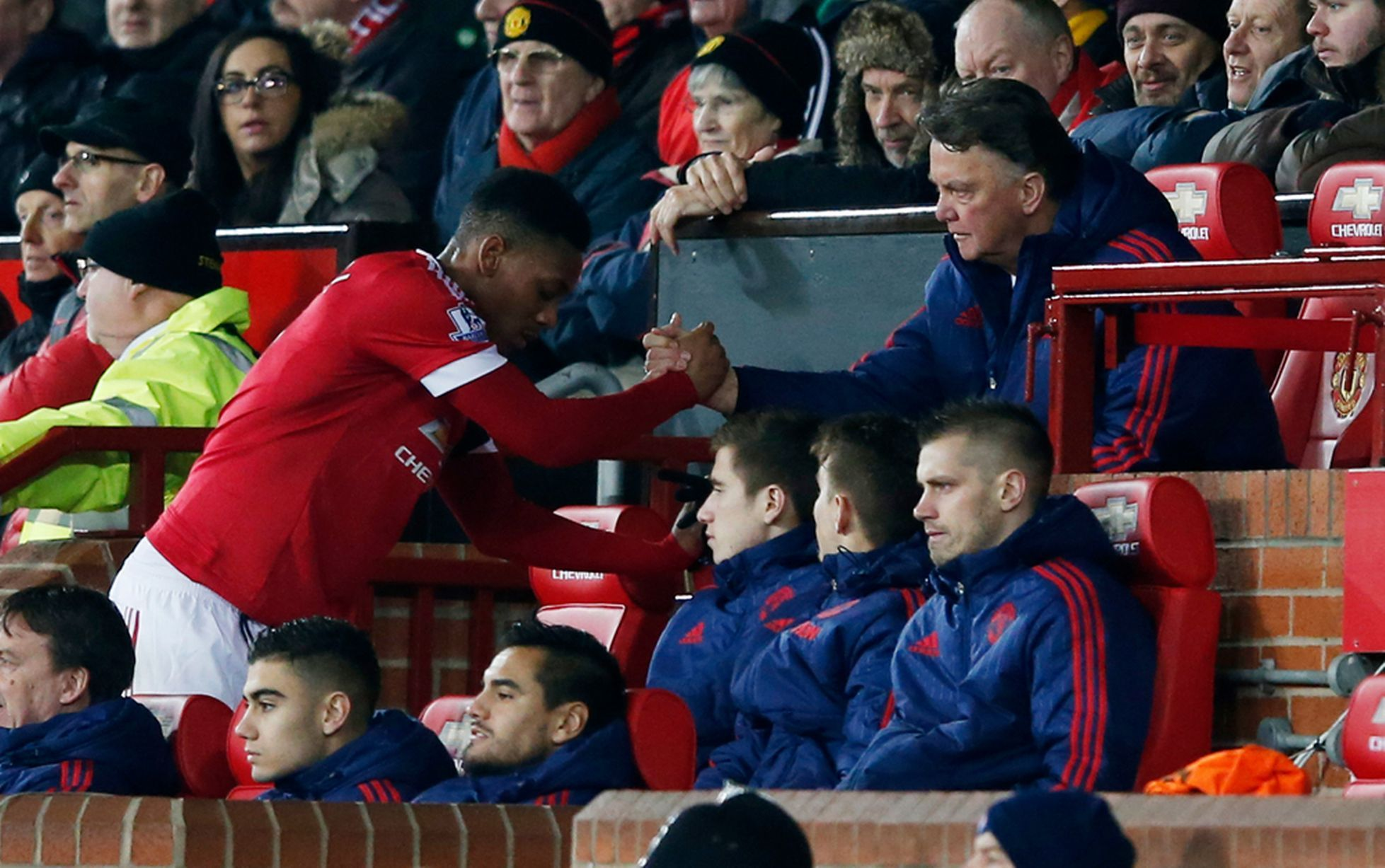 Manchester United's Anthony Martial shakes hands with manager Louis van Gaal as he is substituted