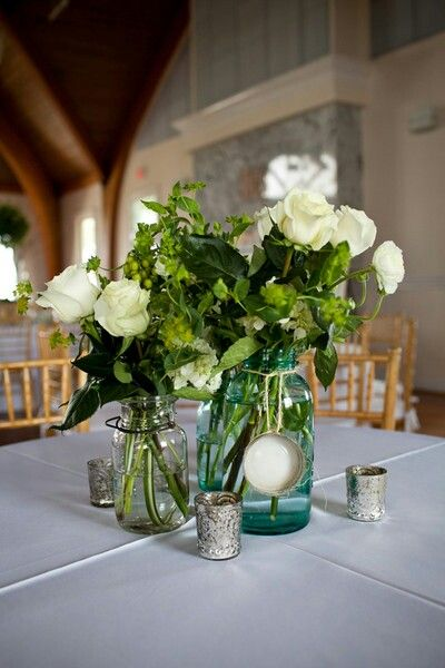 simple wedding centerpieces loose roses and lots of greens when rh pinterest com