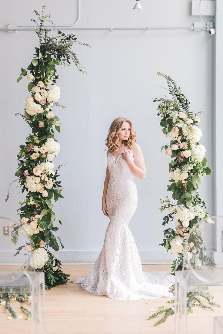 BLUUMBLVD designed an asymmetrical wedding archway or