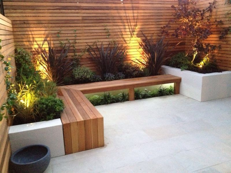 its that white raised beds wooden seating lighting and restrained planting again awesome modern landscape lighting design ideas bringing