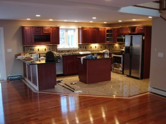 Kitchen cabinets and flooring combinations hardwood vs for Hardwood floors vs tile