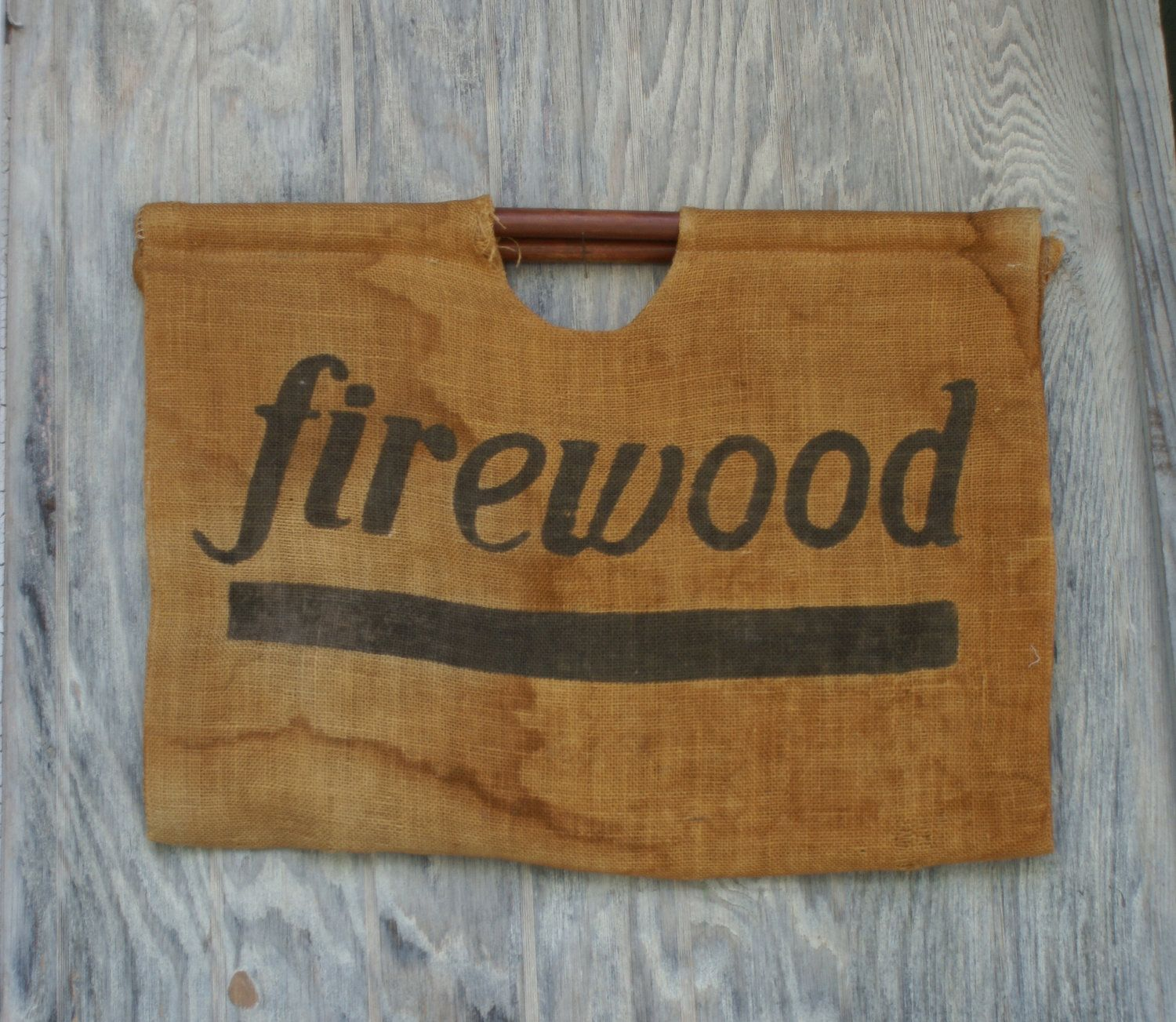 firewood carrier. another use for a potatoe or coffee sack