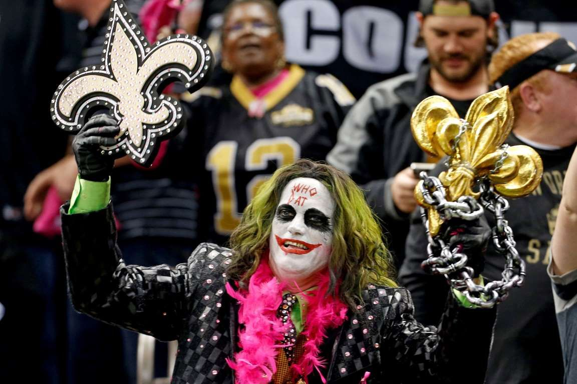 New Orleans Saints Fans In Costume Cheer During A Game