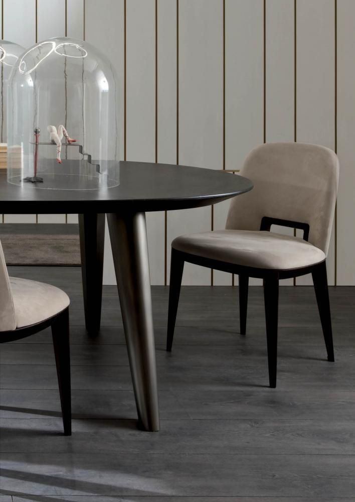Furniture - Chairs - Margaret | Laurameroni   -  The Margaret chair is characterized by sinuous lines that connect gently the back to the seat. The long, narrow legs intersect with the angular structure, creating harmonious details. The main and distinctive element of the chair is the handle, integrated in the backrest's curves.   -  #chair #design #furniture #designfurniture #designchairs